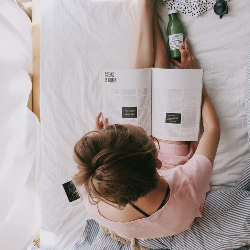 start morning right with a girl in pink shirt reading a book